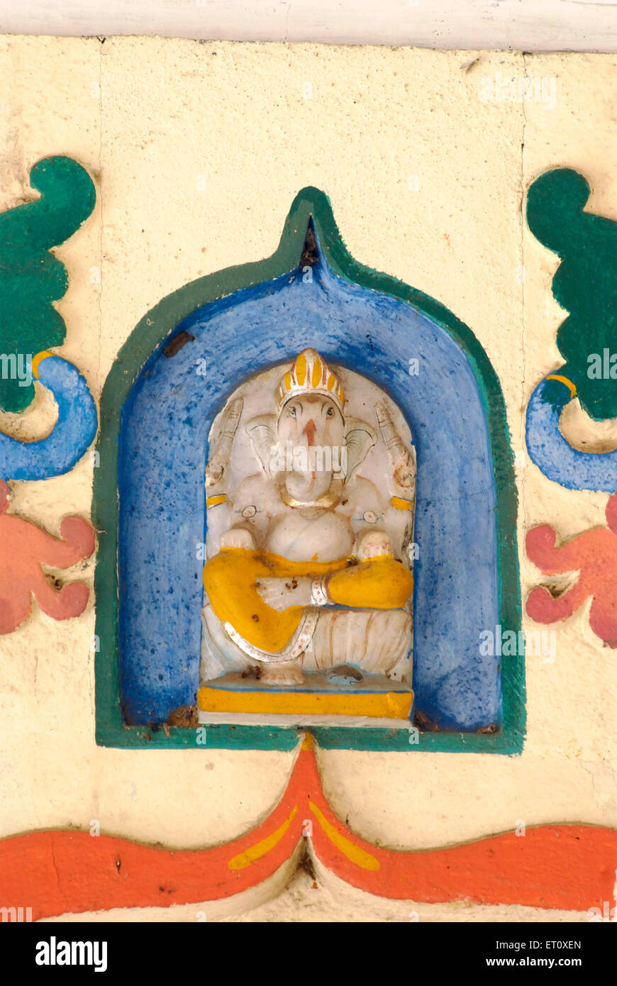 Relief marble carved idol of lord Ganesh on the top of door of Vitthal temple at Parvati hill ; Pune ; Maharashtra ; India & Relief marble carved idol of lord Ganesh on the top of door of Stock ...