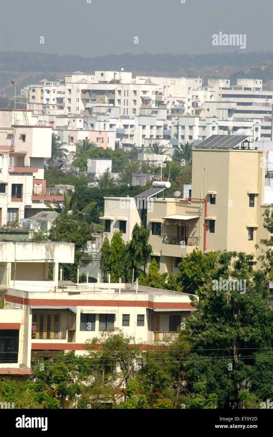 Modern housing complexes and dense greenery ; Pune ; Maharashtra ; India - Stock Image