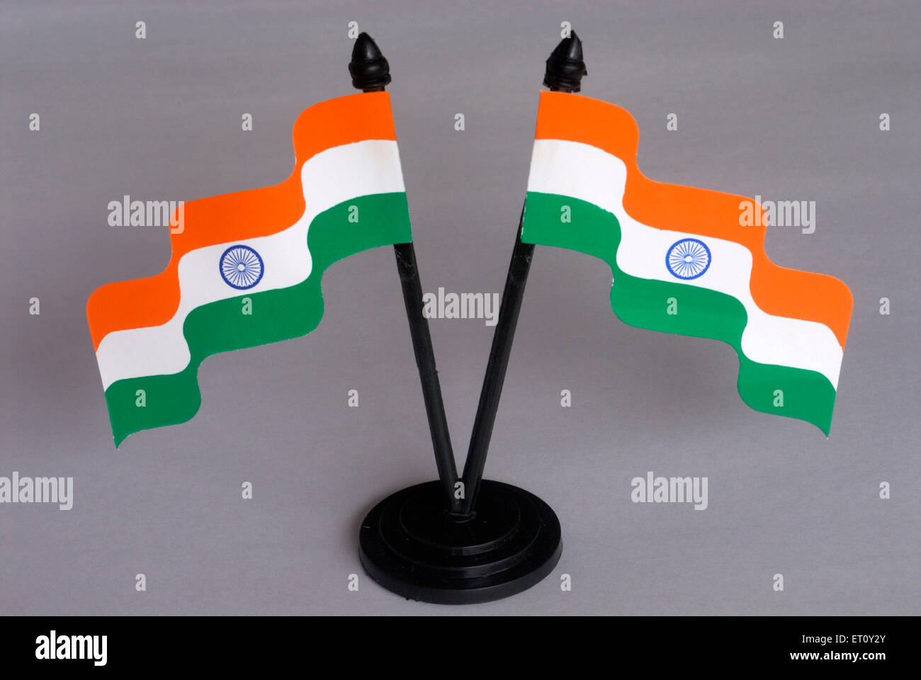 Two flying Indian tricolour ; national flag with blue Ashoka Chakra hoisted to pole ; paper material ; Borivali - Stock Image