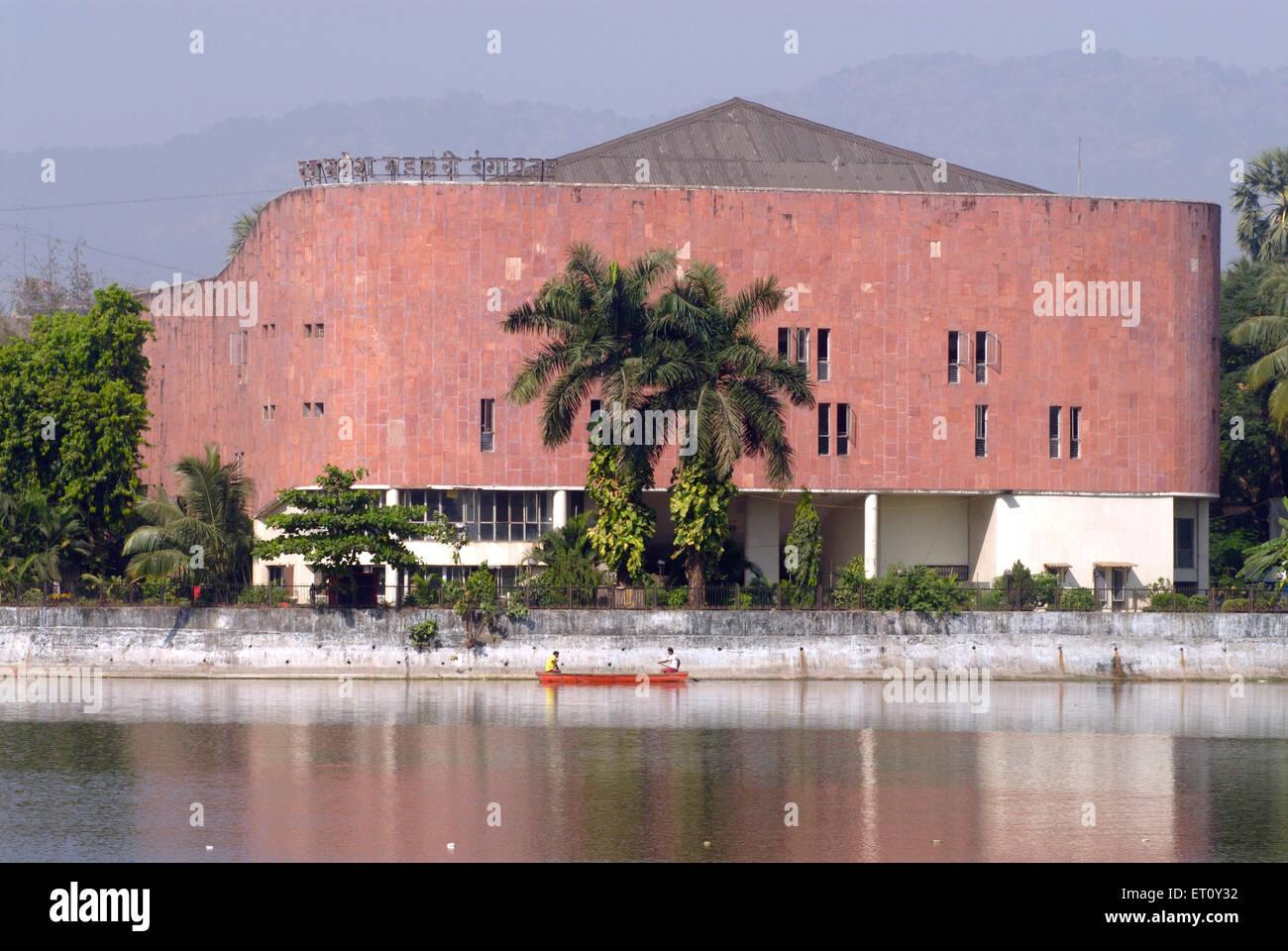 Ram Ganesh Gadkari Rangayatan Marathi drama theatre reflection in water of Masunda lake or Talao Pali ; Thane - Stock Image