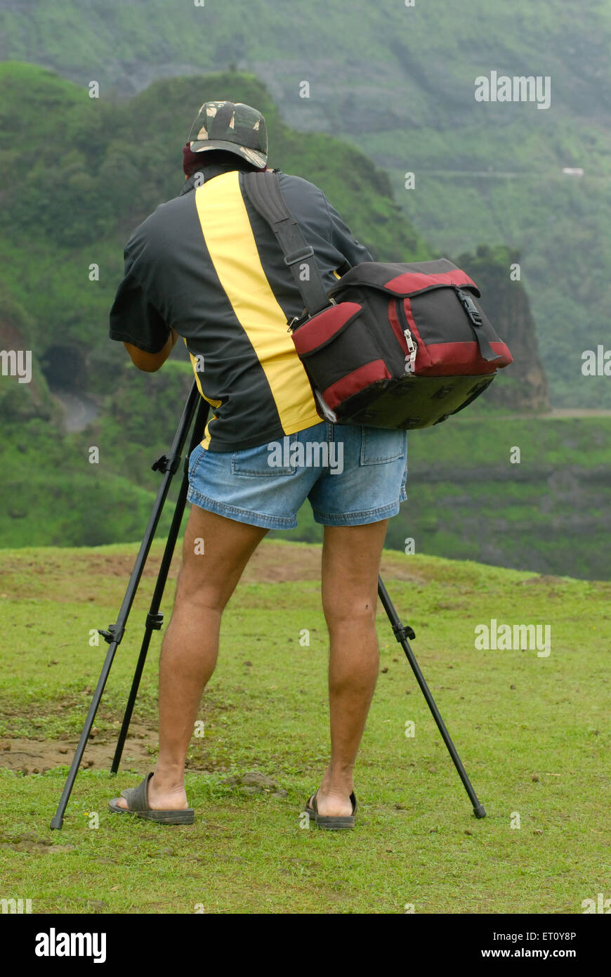 Photographer shooting at Malshej Ghat ; Maharashtra ; India MR# 778C - Stock Image