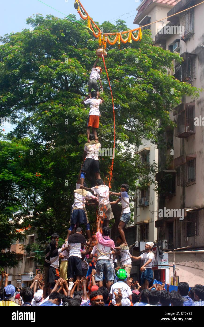 Human pyramid broke dahi handi on janmashtami gokulashtami festival at Dadar ; Bombay Mumbai ; Maharashtra ; India - Stock Image