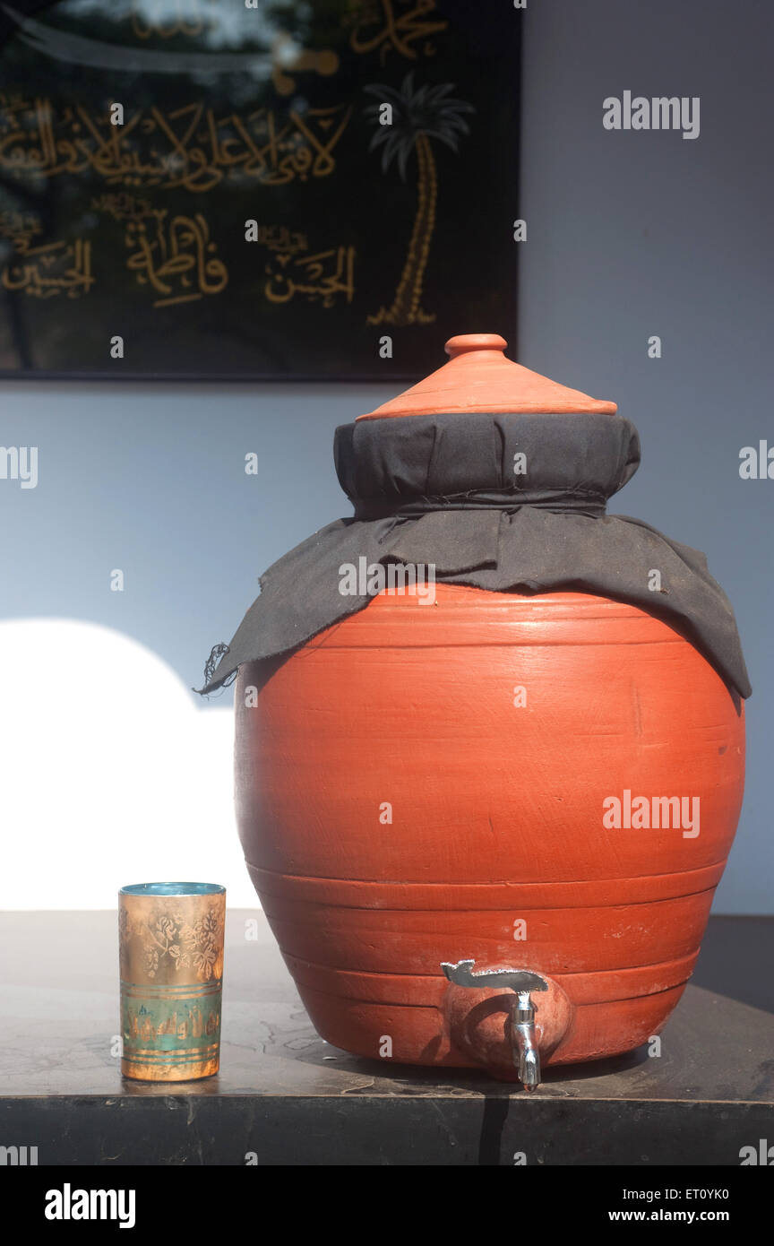 Earthen pot with glass 2009 - Stock Image