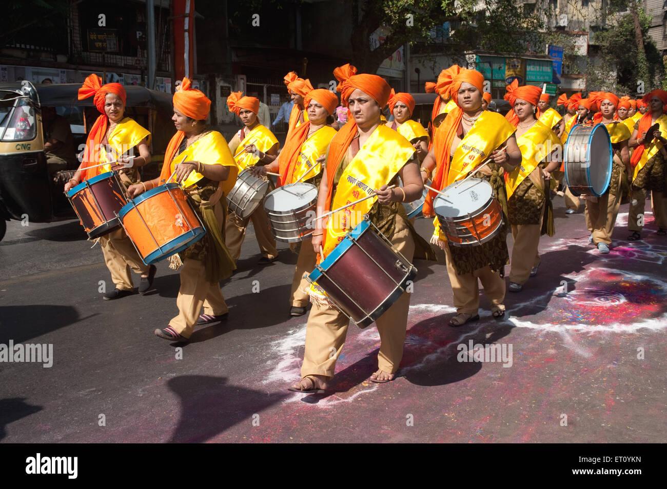 Women beating drums in procession of gudi padva festival ; Thane ; Maharashtra ; India 2010 - Stock Image
