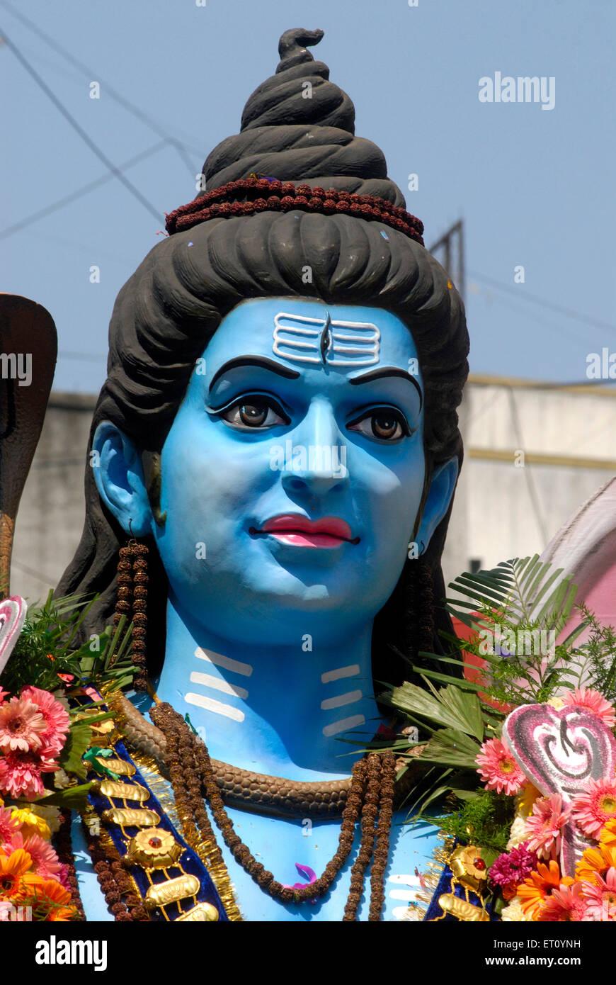 Procession of huge idol of lord Shiva with Nandi bull celebrating Mahashivratri festival ; Pune ; Maharashtra ; - Stock Image