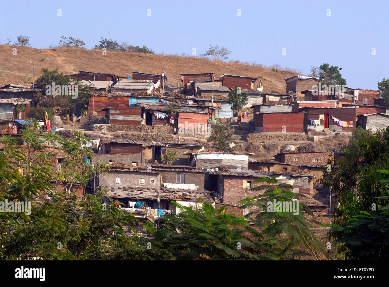 Slum over Parvati hill ; Pune ; Maharashtra ; India - Stock Image