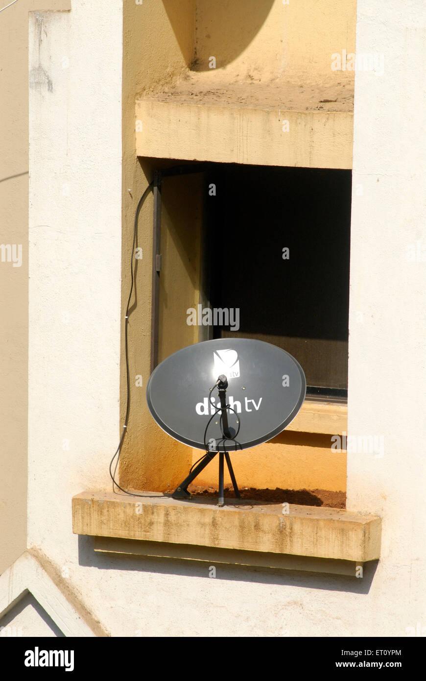 Black dish antenna for television direct to home DTH service via satellite  ; Borivali  ;  Bombay Mumbai - Stock Image