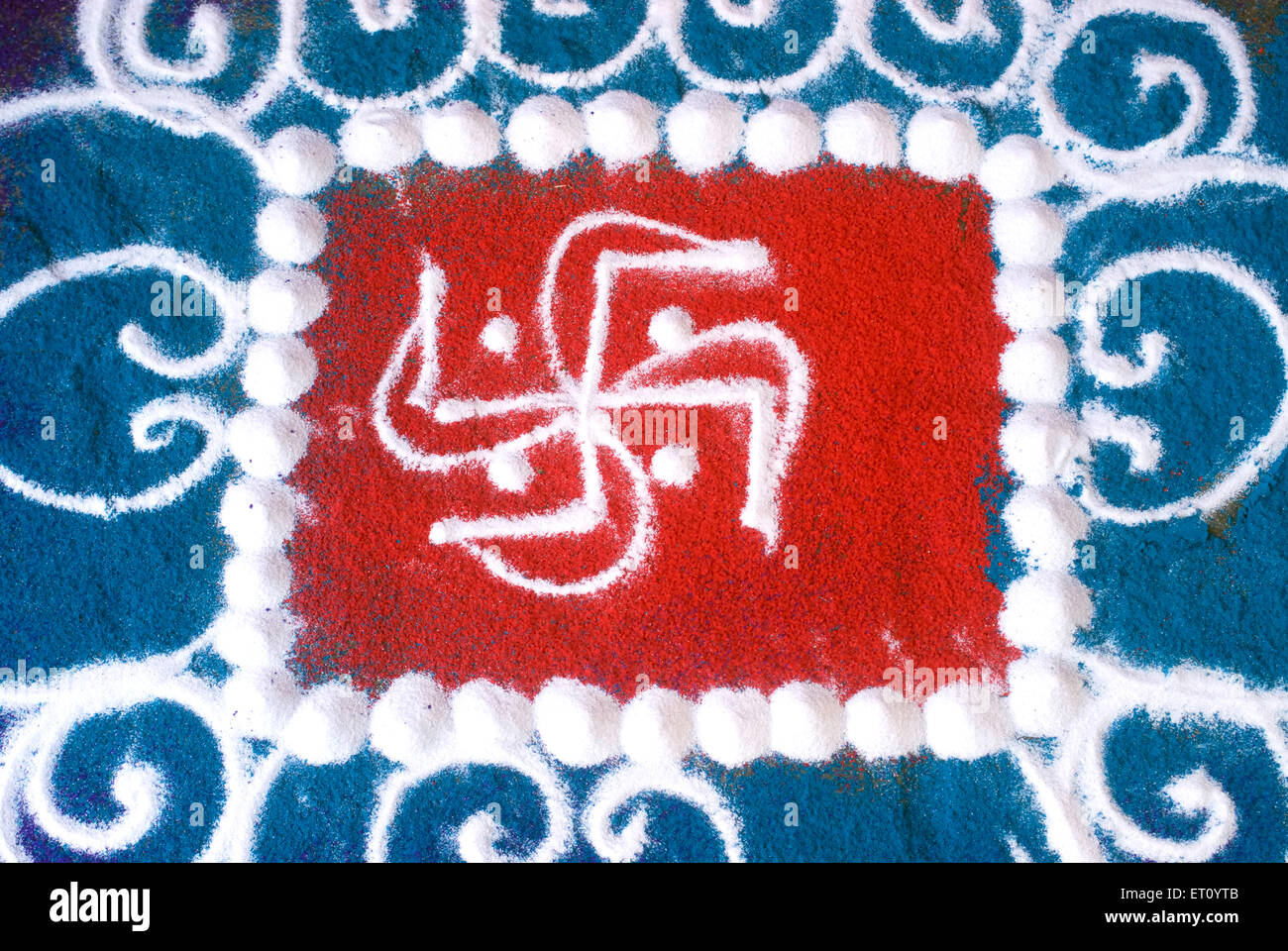 Swastika auspicious symbol rangoli floor design for celebrating Gudi Padva New Year of Hindu at Thane ; Maharashtra - Stock Image