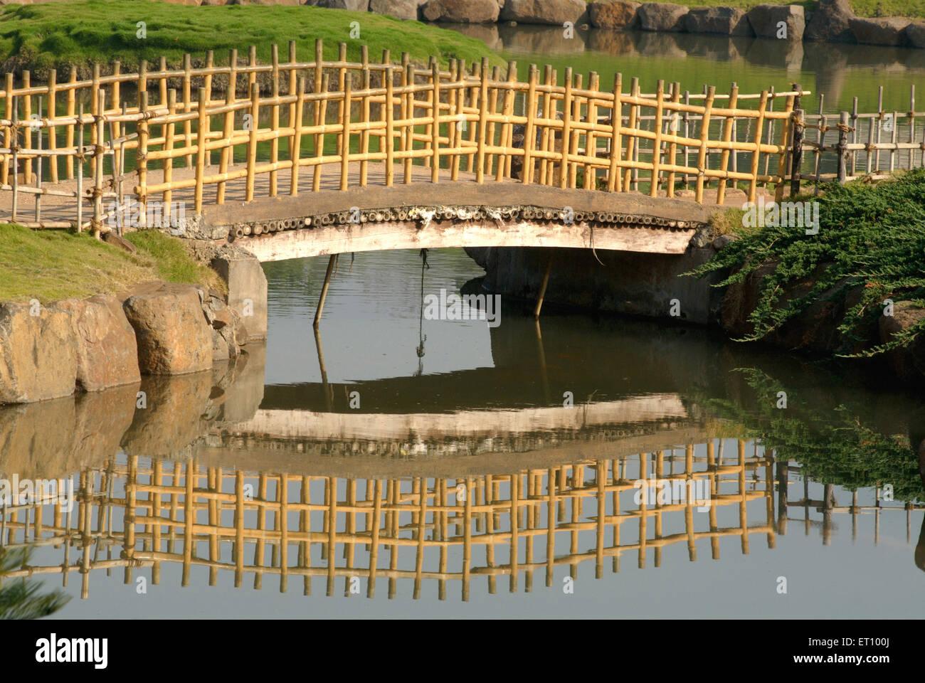 Bridge over pond in okayama friendship or p l. deshpande garden ...