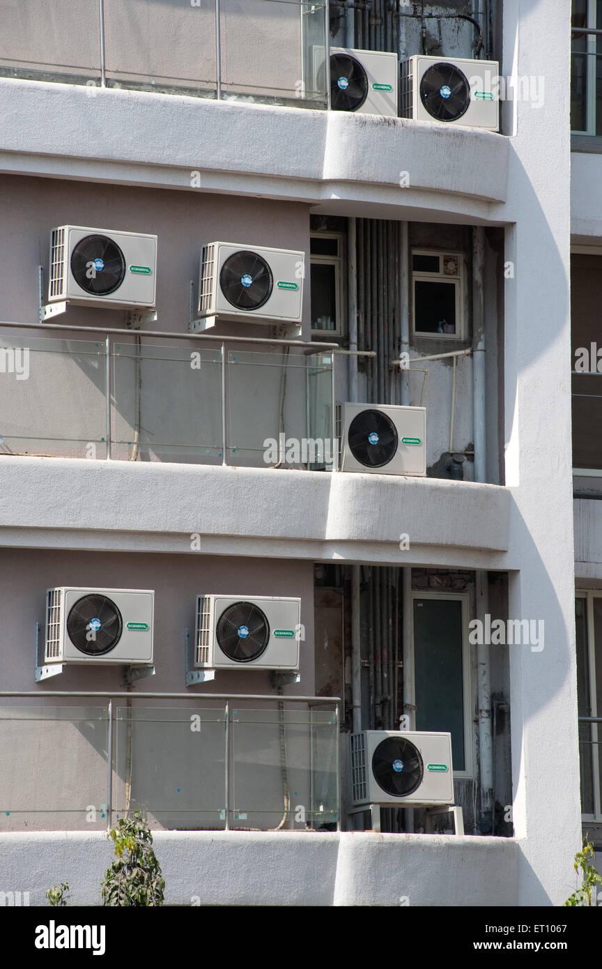 Pumps of air condition kept at external wall of building ; Bombay Mumbai ; Maharashtra ; India 2010 - Stock Image