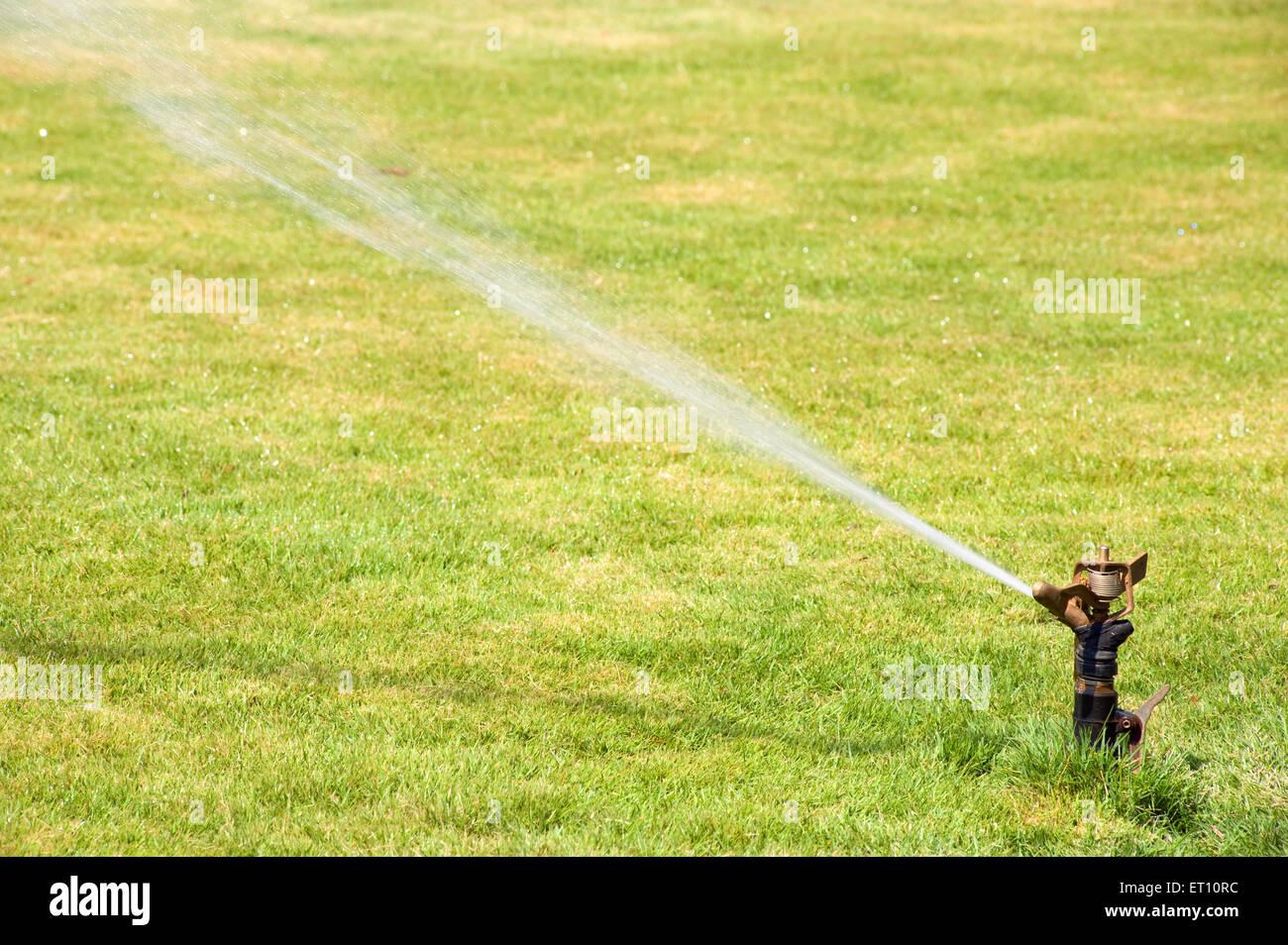 Water sprinkler at garcia de orta now municipal garden ; Panjim ; Goa ; India - Stock Image