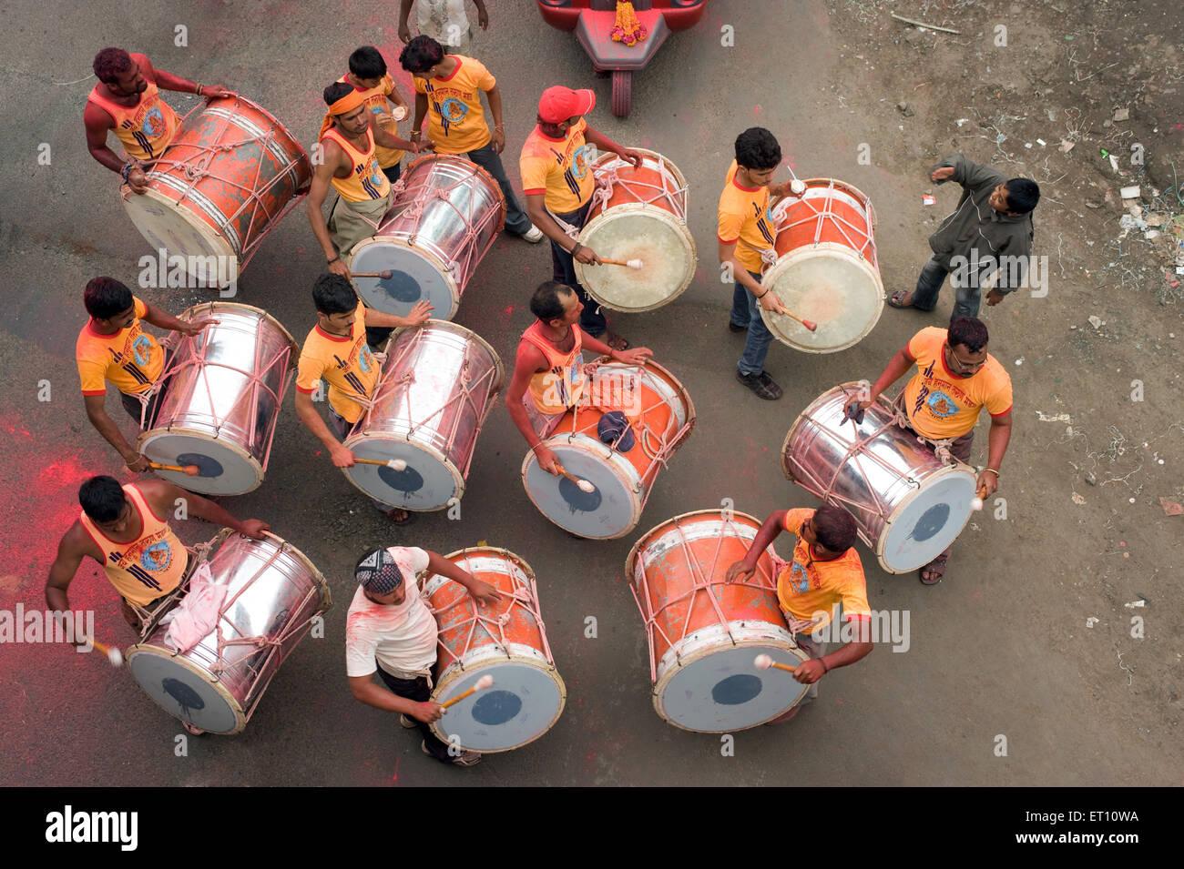Band group beating big drum to Ganpati festival at Pune Maharashtra India Asia 2011 - Stock Image