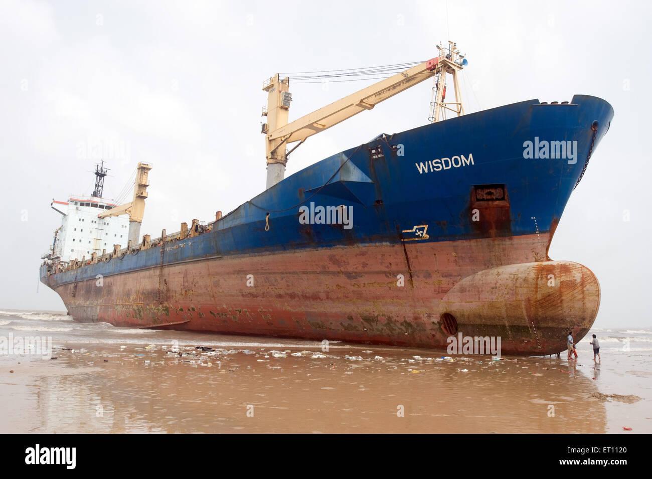 Wisdom the major cargo ship came at Juhu Beach Mumbai India Asia - Stock Image