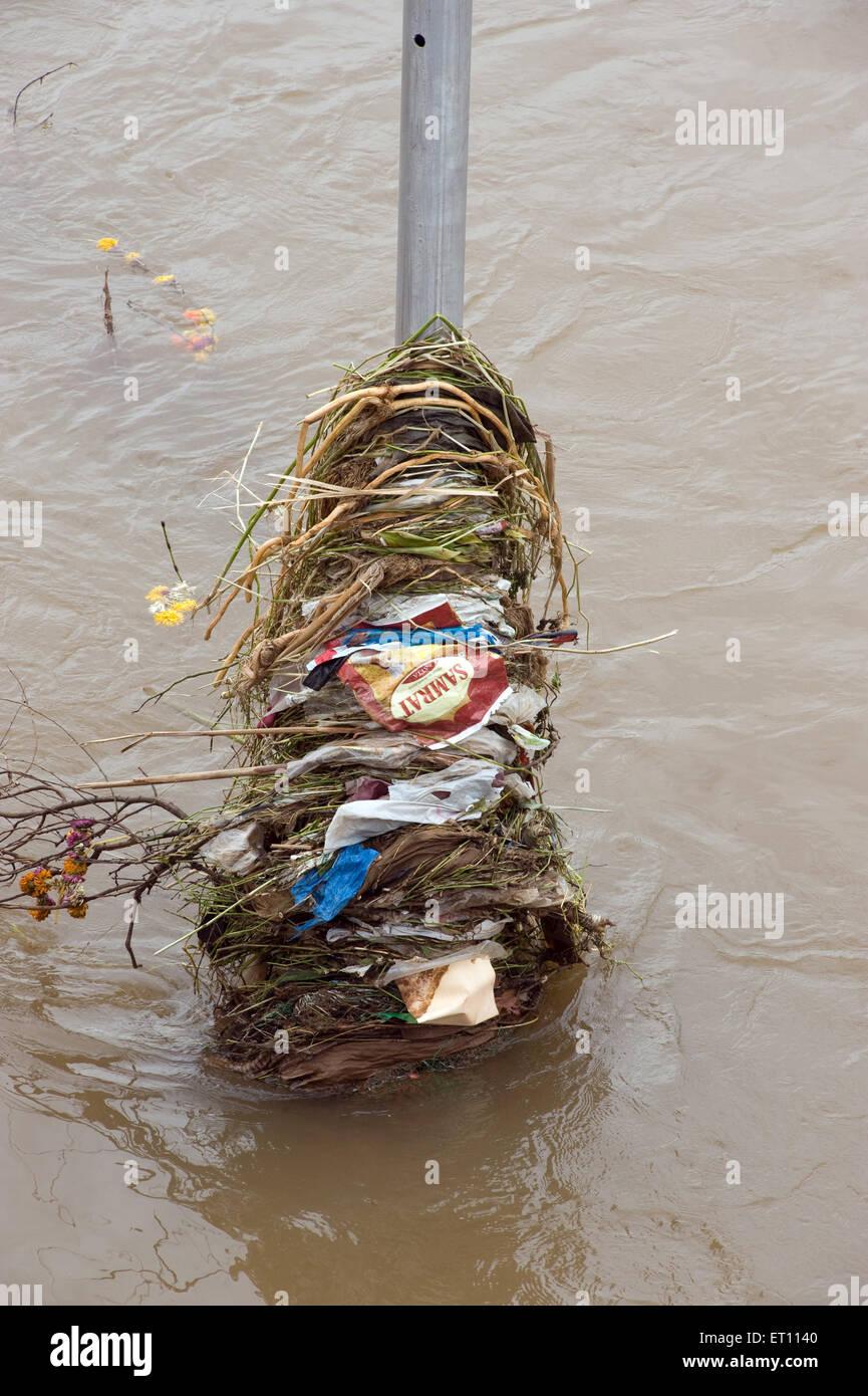 Garbage flown block by lamppost at Pune Maharashtra India 2011 - Stock Image