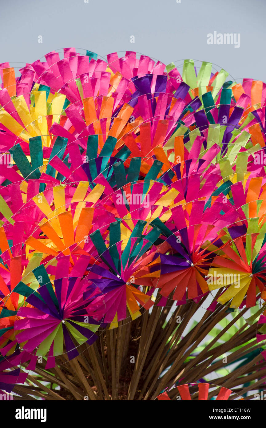 Colourful wind wheels for selling at Juhu Beach Mumbai India Asia - Stock Image
