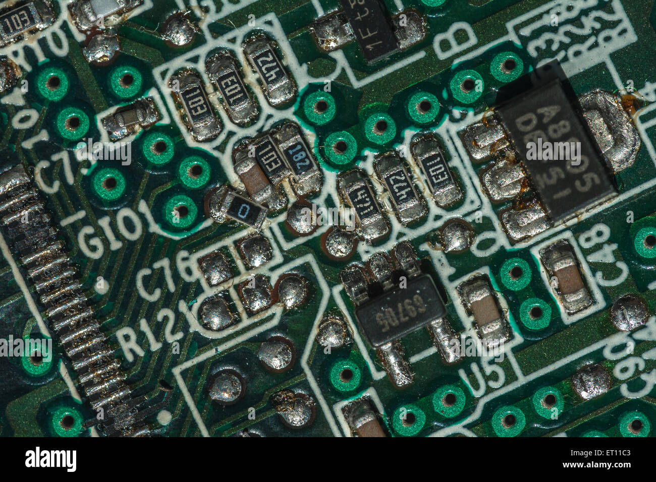 Macro-photo of printed circuit components on a PC motherboard. Wiring inside computer. - Stock Image