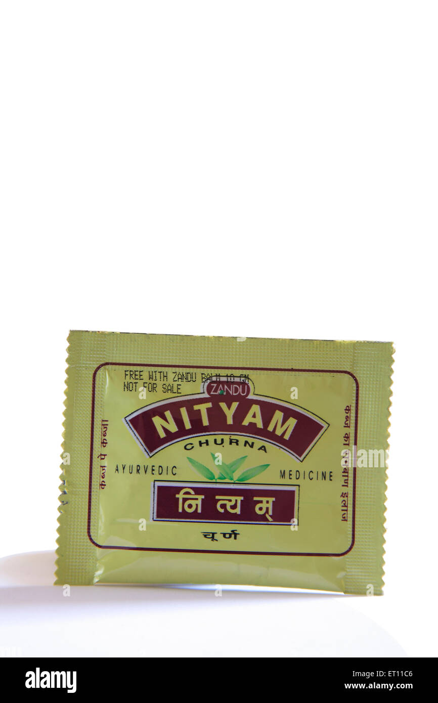 Ayurvedic medicine nityam churna powder in packet relief from chronic constipation and associated symptoms on white - Stock Image