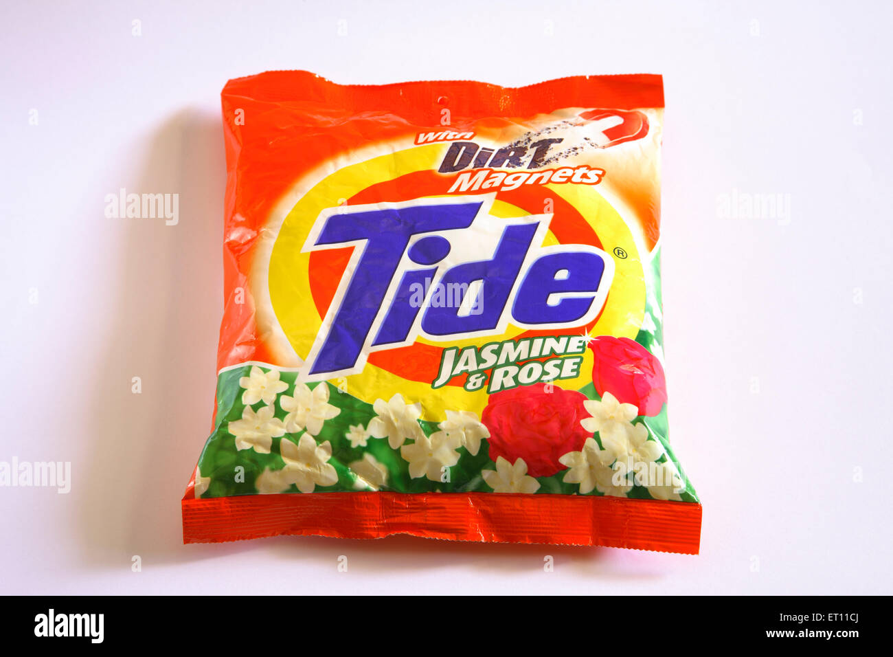 Detergent powder Tide packet on white background - Stock Image