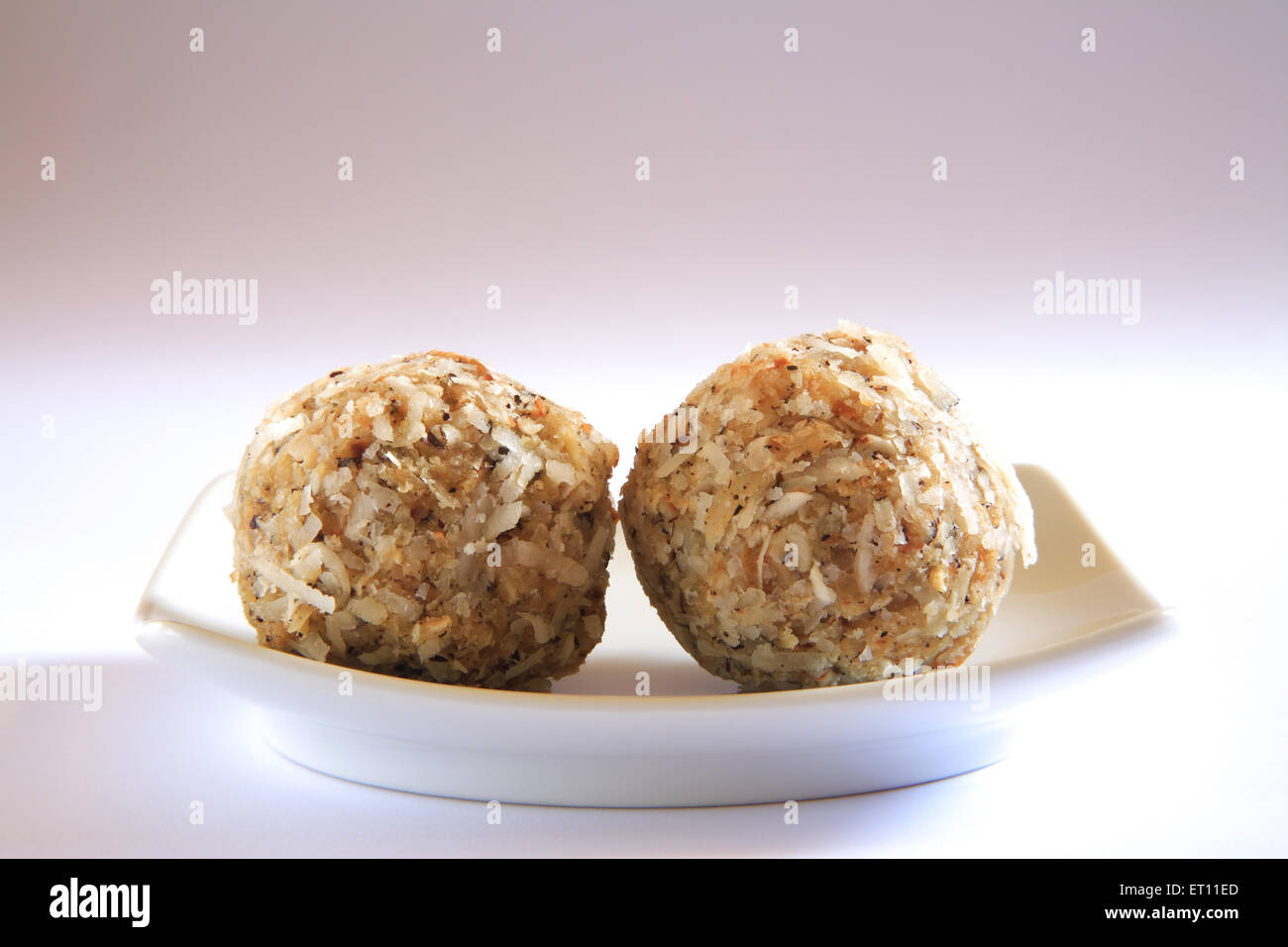 Mithai ; gond laddoos in tray on white background - Stock Image
