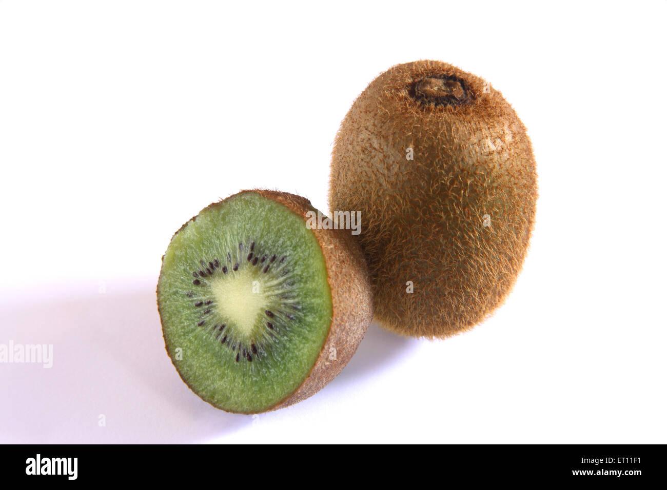 Fruit ; one full and half kiwi on white background - Stock Image