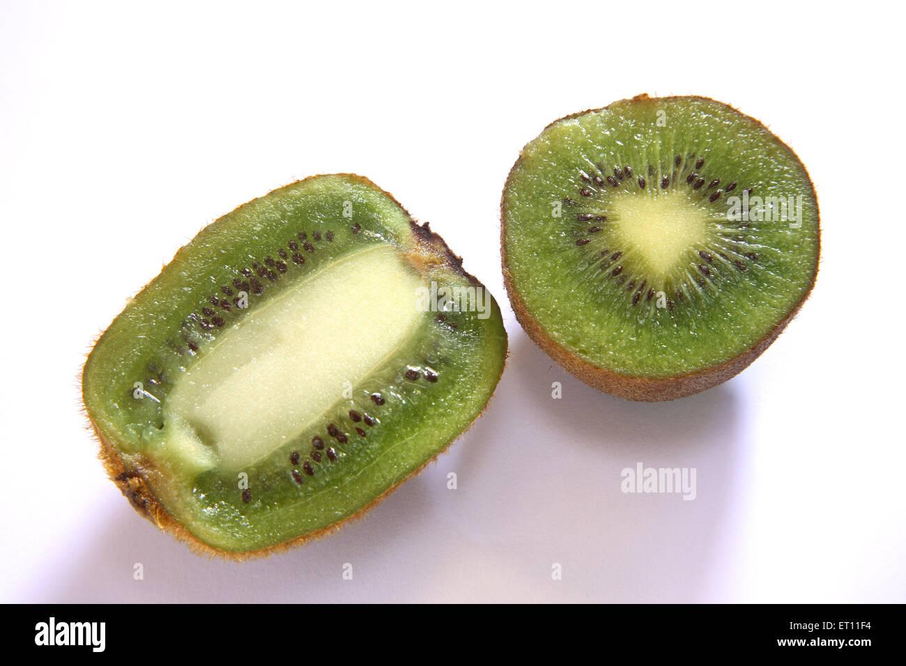 Fruit ; half kiwi on white background - Stock Image