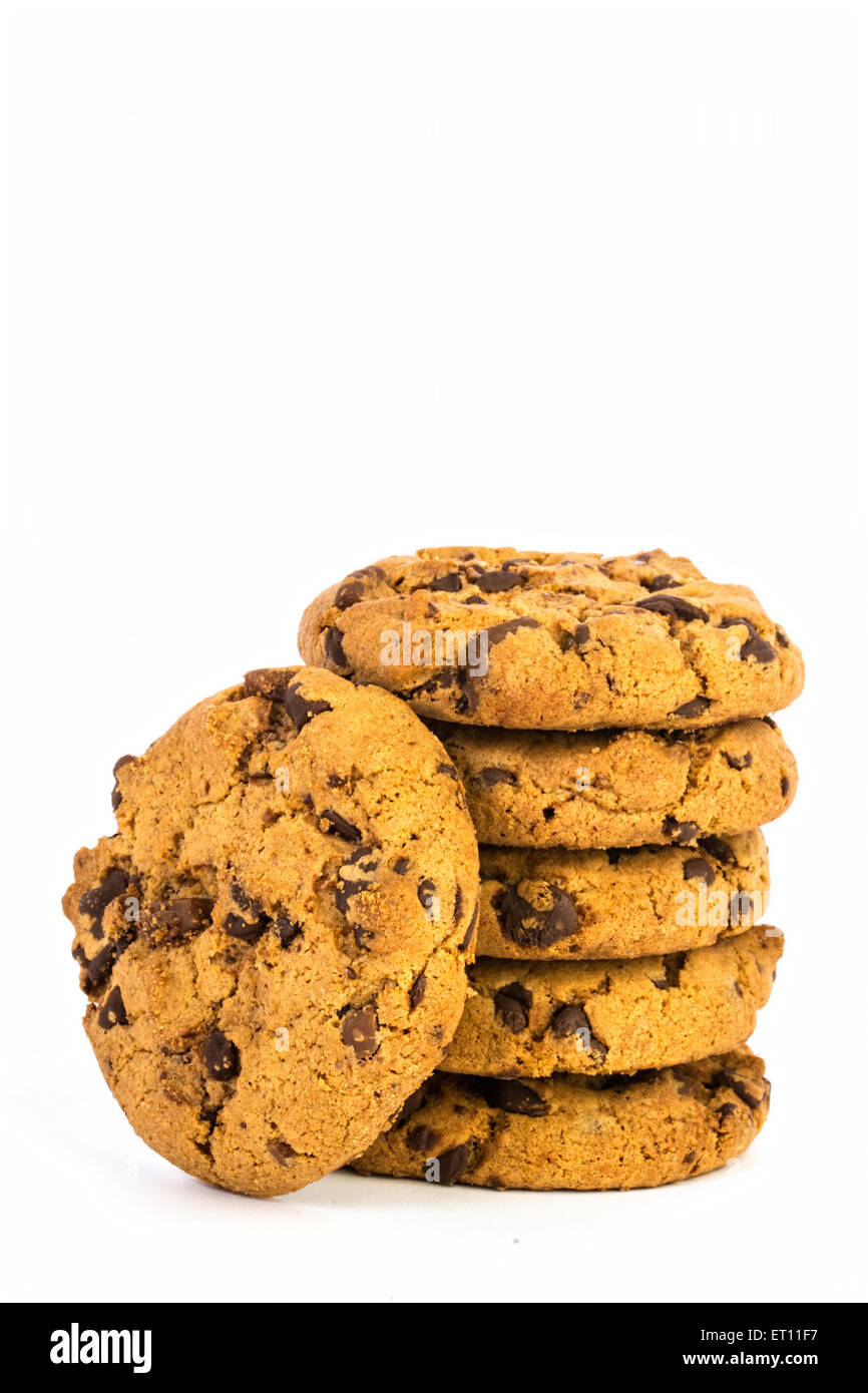 pille of chocolate chip cookies in white background Stock Photo