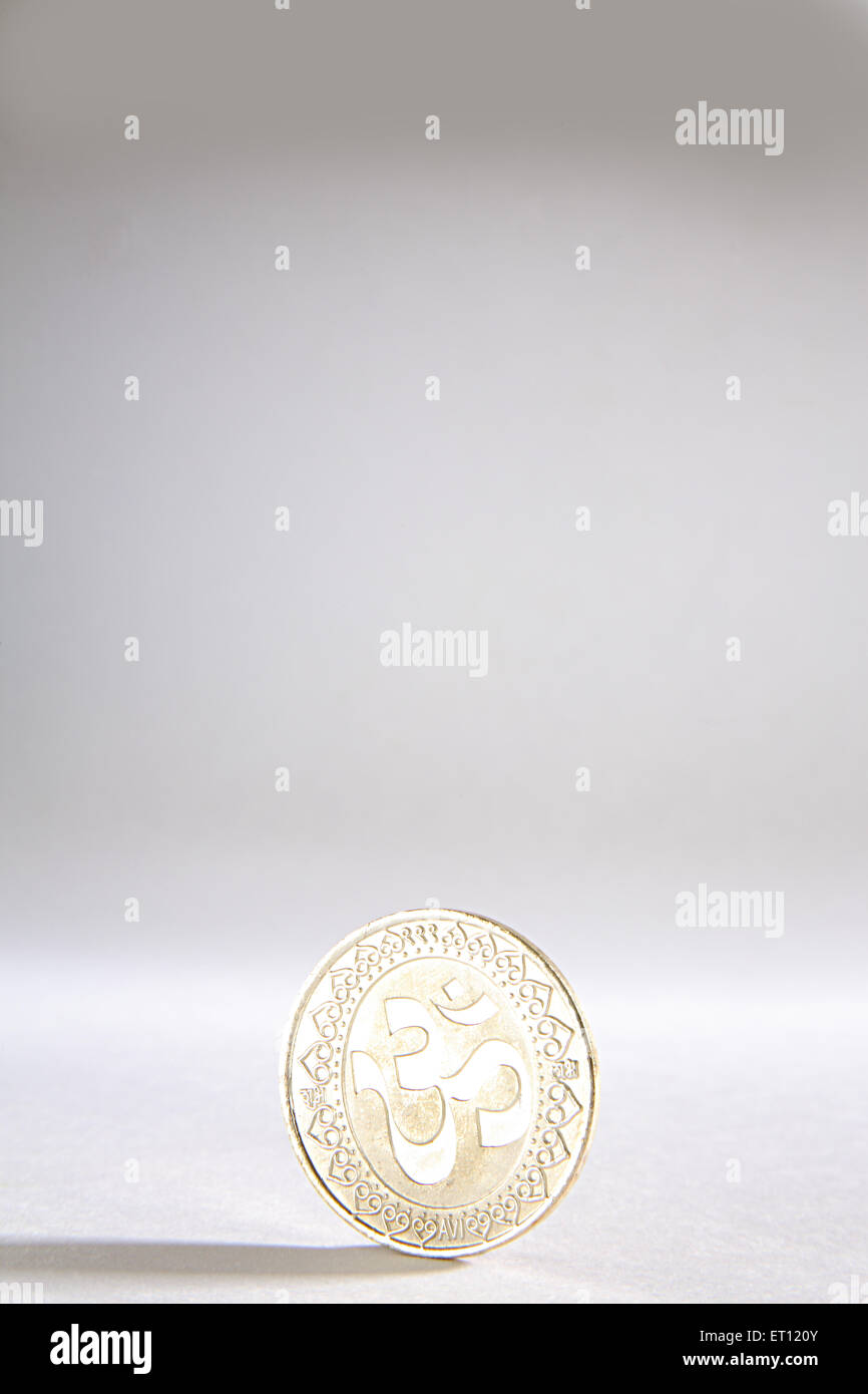 Silver coin with Om cosmic creation ; India - Stock Image