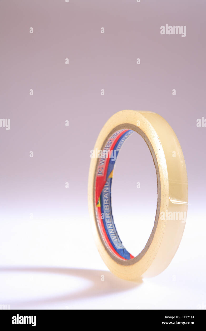 Transparent adhesive tape on white background - Stock Image