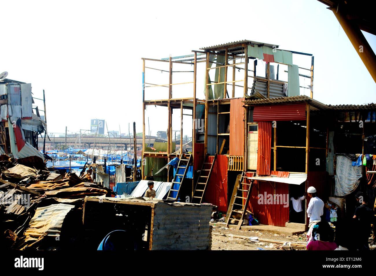 Reconstruction after great inferno in garib nagar at bandra ; Bombay ; Mumbai ; Maharashtra ; India - Stock Image