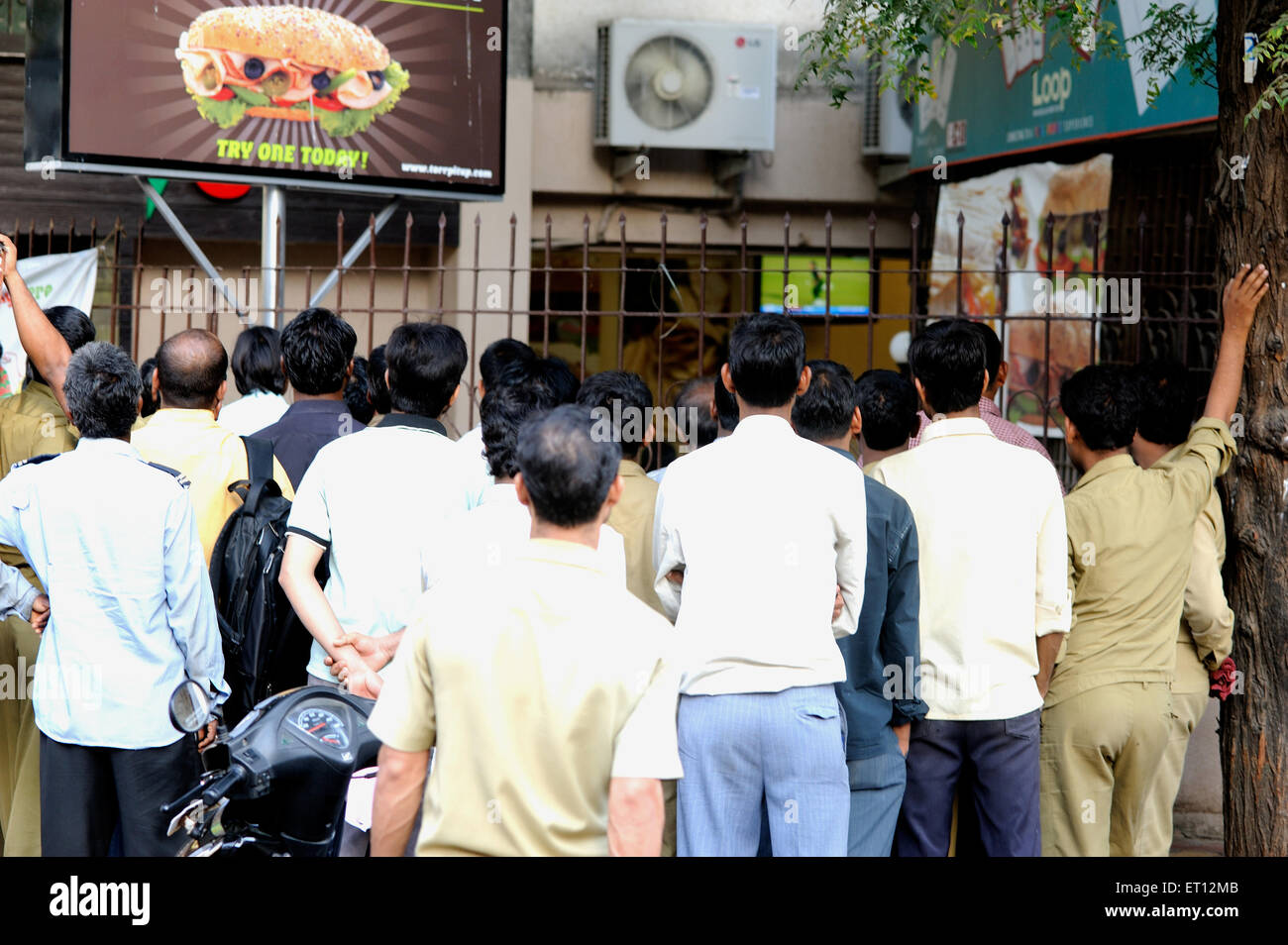 People watching cricket match ; India - Stock Image