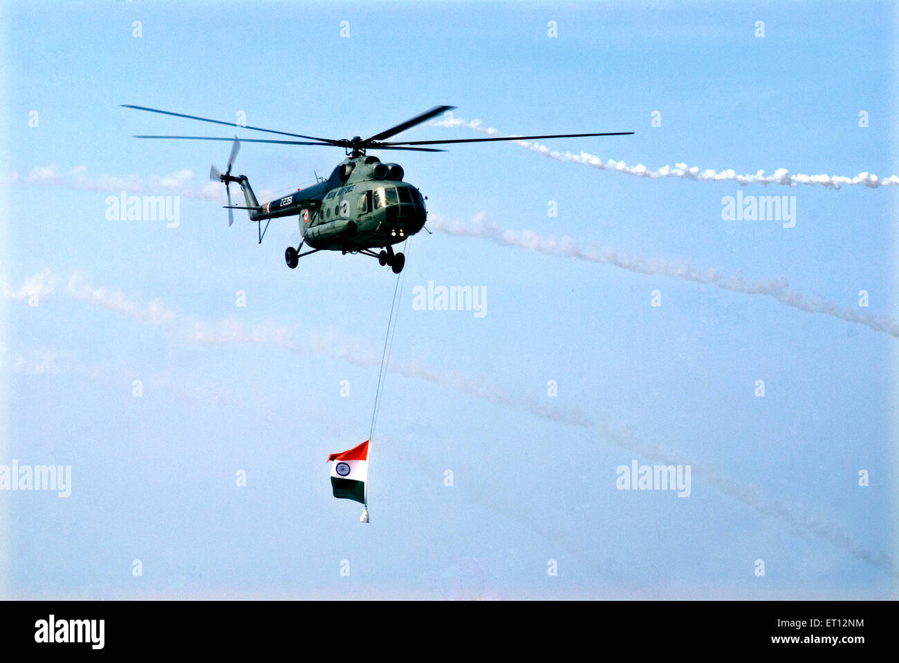 Helicopter flying with national flag against air attack on Air Force Day ; Trivandrum ; Kerala ; India 20 July 2008 - Stock Image