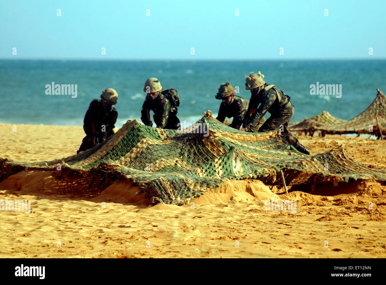 Capturing enemy bunker beach landing operations by Indian army during Army day at Shanghumugom beach ; Trivandrum - Stock Image