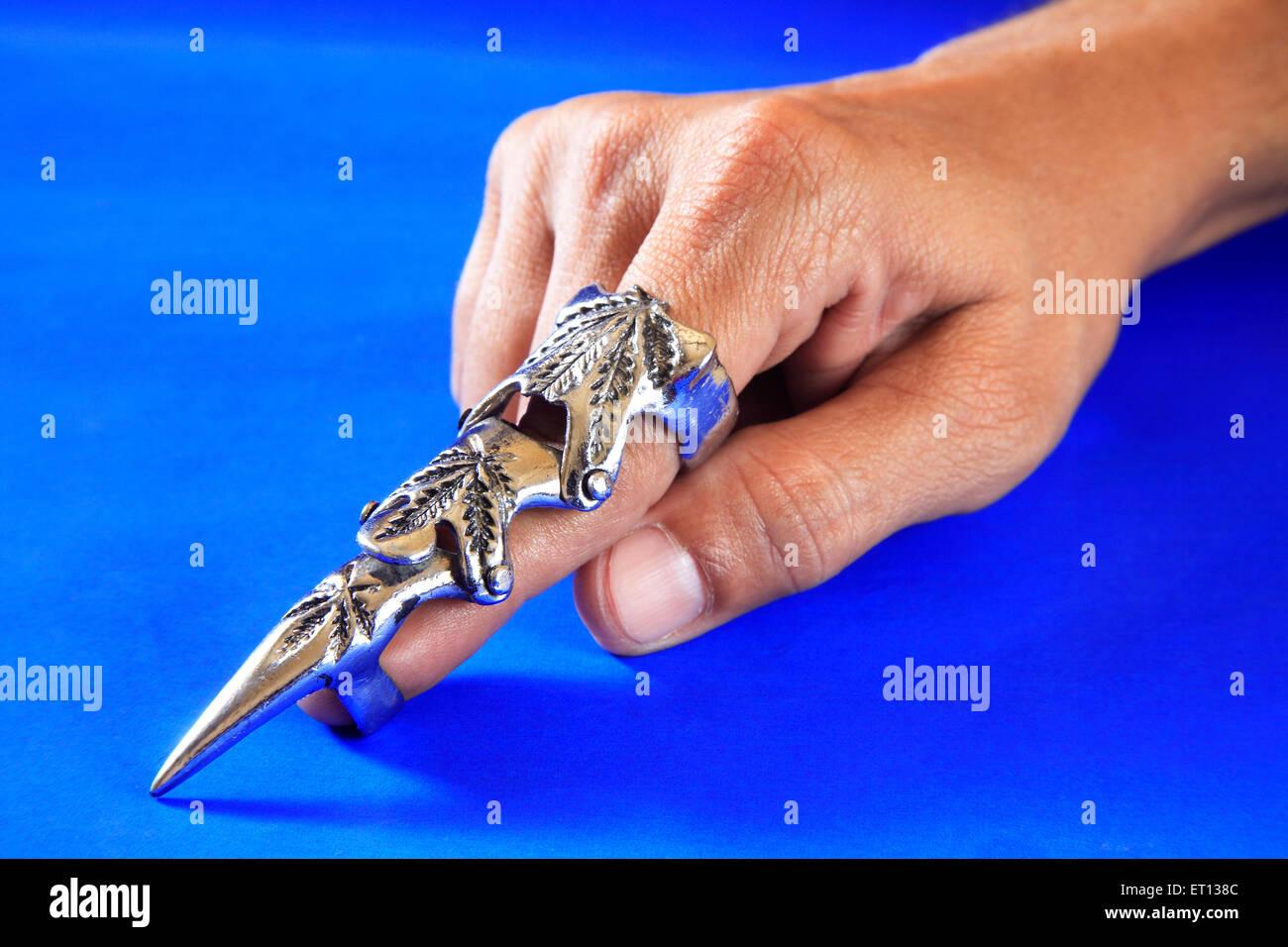 Modern fashion ring on finger ; blue background ; Bombay Mumbai ; Maharashtra ; India MR#201 - Stock Image