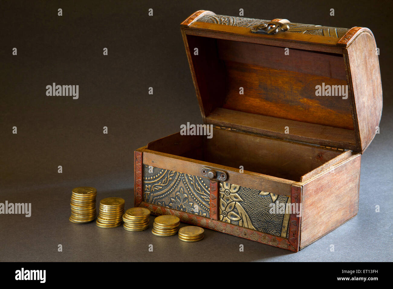 Wooden Jewellery Ornament box with Gold Coin India Asia Nove 2011 - Stock Image