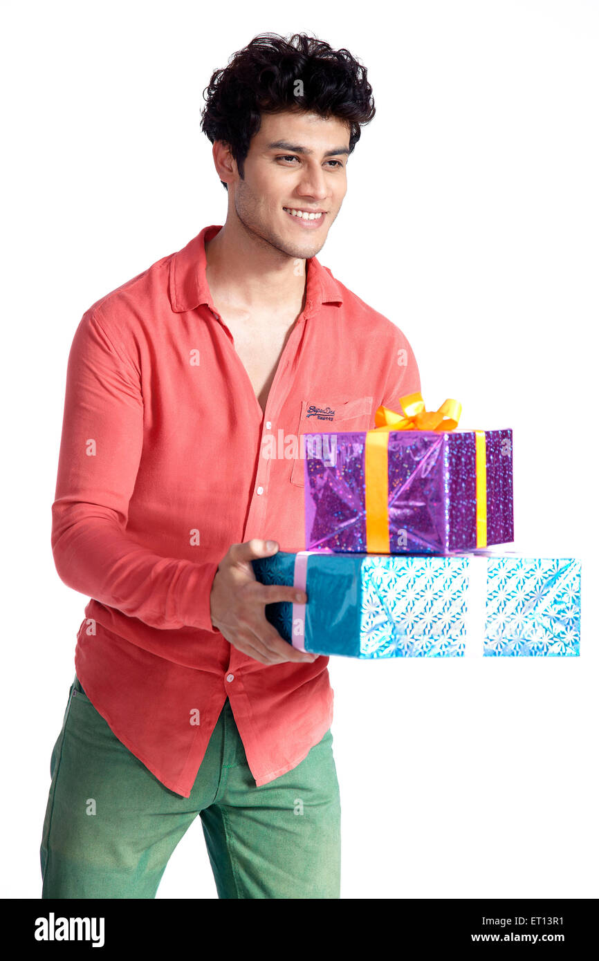 Man Holding Gifts Boxes India Asia MR#790E - Stock Image