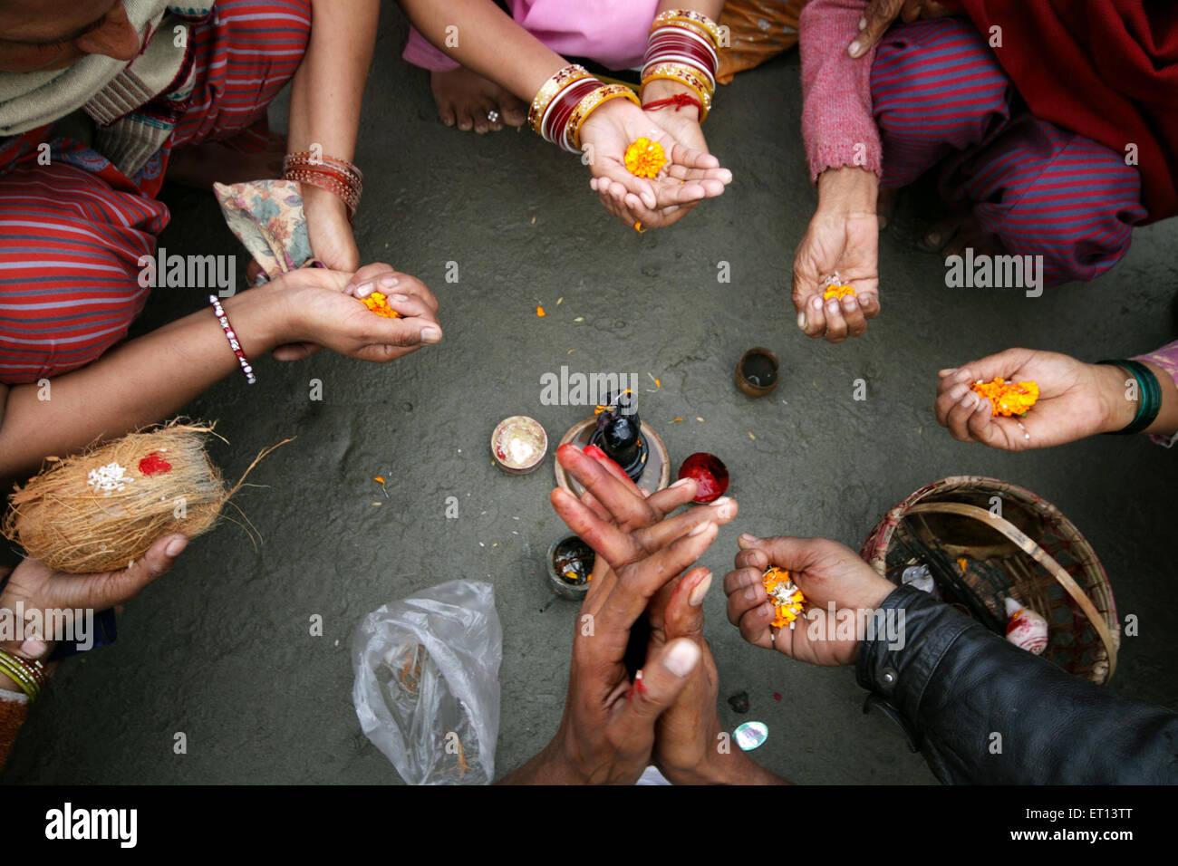 Performing ritual ; Gangasagar fair ; West Bengal ; India - Stock Image