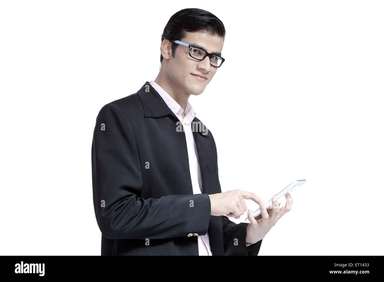 Man Handling Tablet India Asia MR#790E - Stock Image