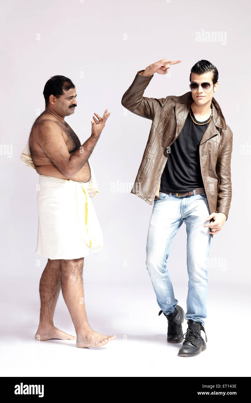 Contrast of Men in Lungi And Blue Jeans India Asia MR#790E - Stock Image