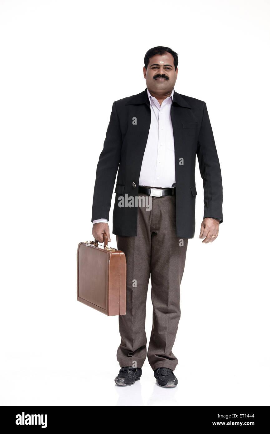 Businessman Holding Briefcase India Asia MR#790E - Stock Image
