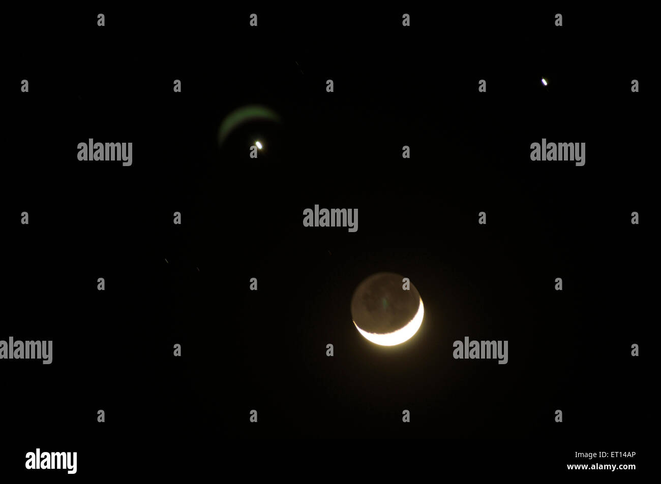 Celestial rarity three brightest objects in sky Jupiter Venus and moon come closest 1 December 08 bright planets - Stock Image