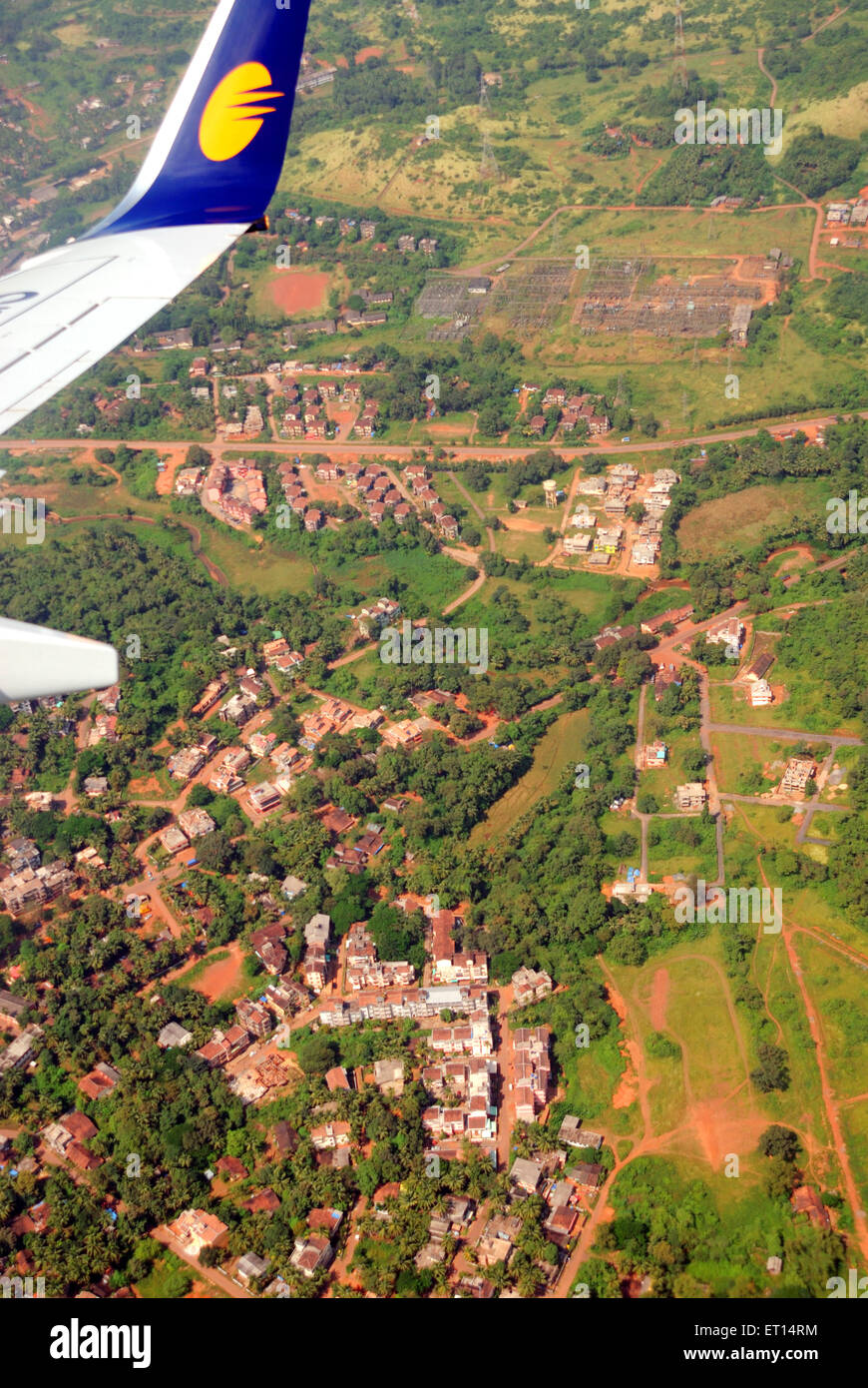 Aerial view of housing colony and aircraft wing ; Goa ; India - Stock Image