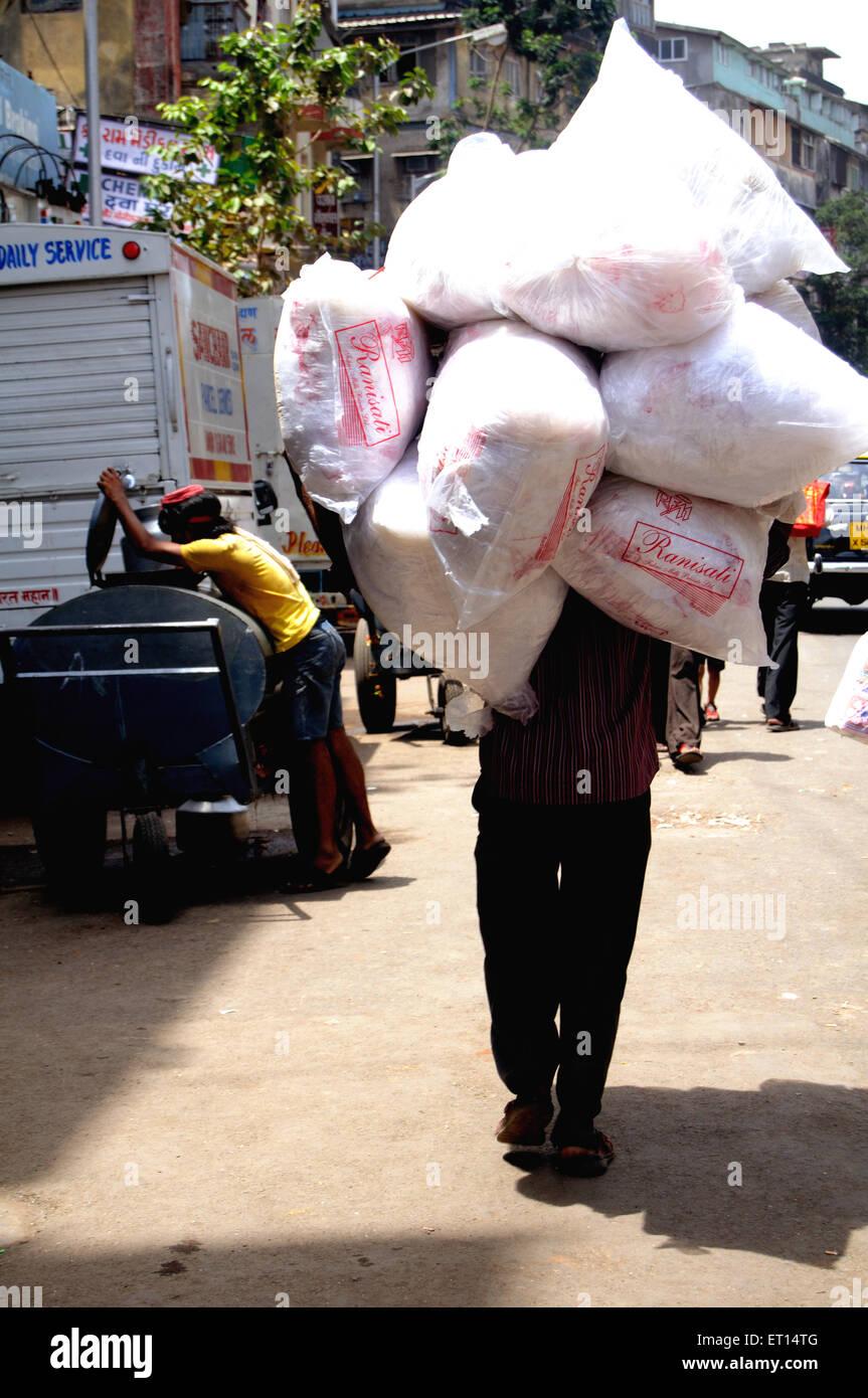 man carrying sacks ; India Stock Photo