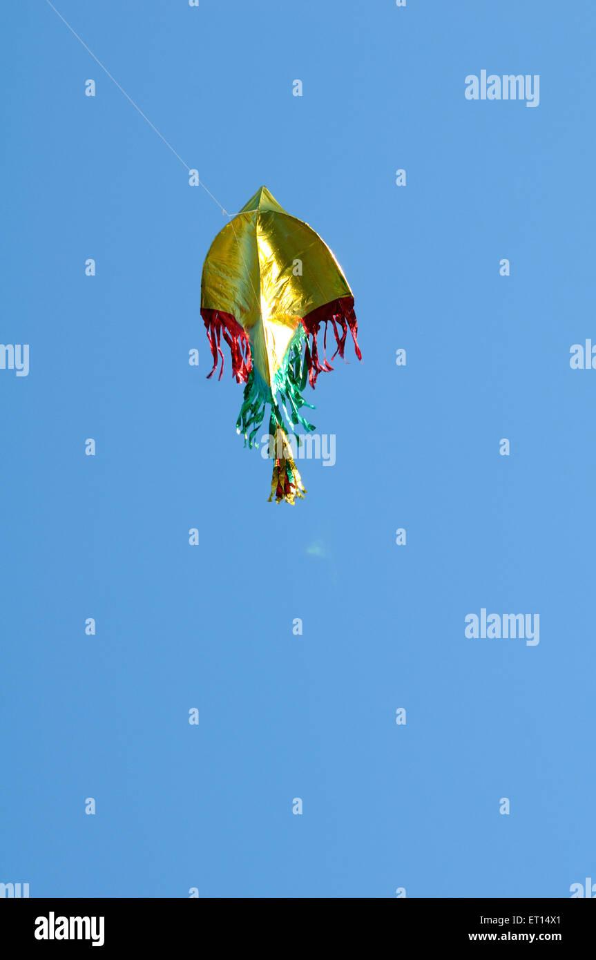 Kite flown on makar sankranti at Juhu ; Bombay Mumbai ; Maharashtra ; India - Stock Image