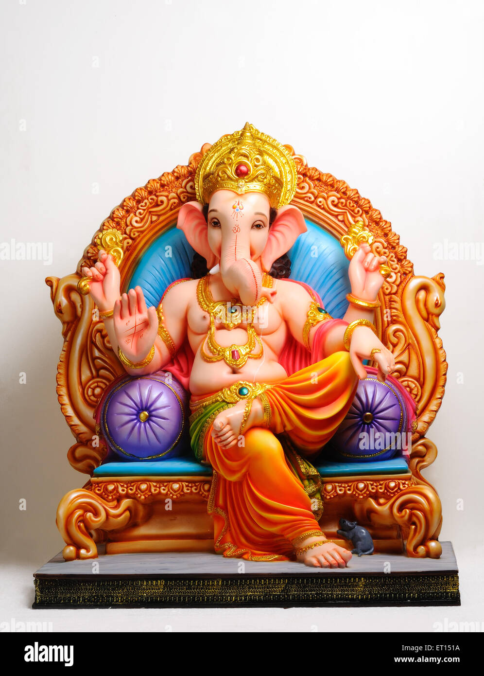 clay statue of lord ganesh sitting on throne stock photo: 83619126