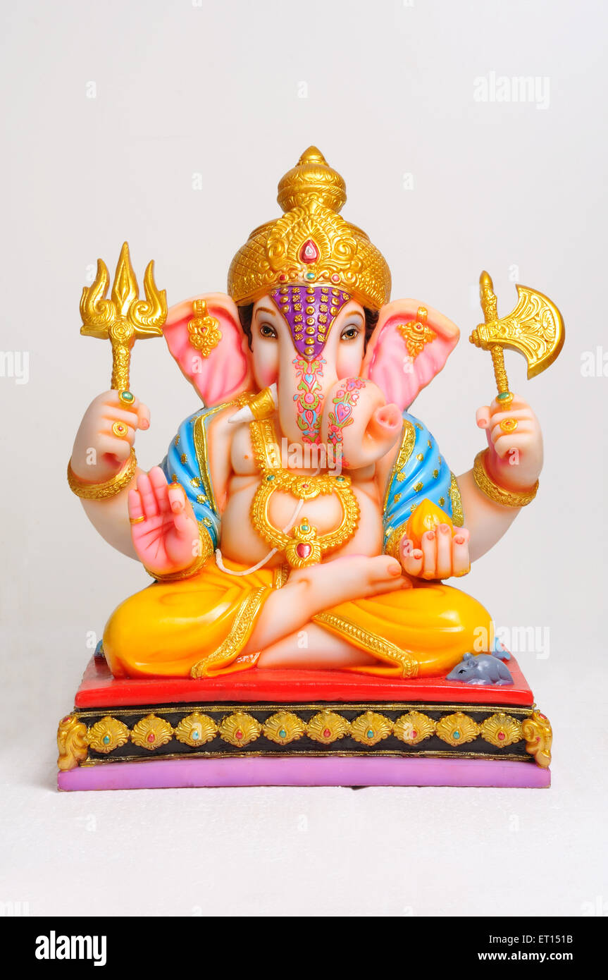 Clay statue of lord ganesh sitting on asana - Stock Image