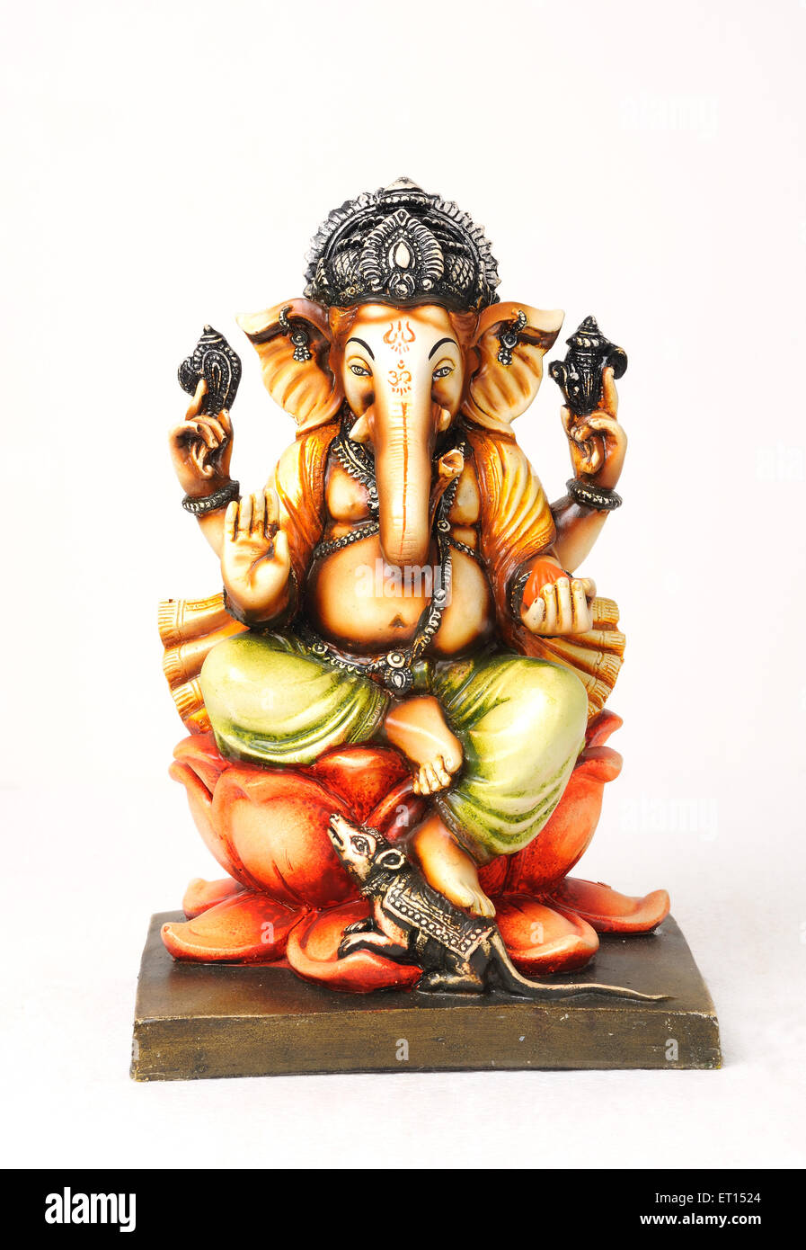 Clay statue of lord ganesh sitting on lotus with mouse - Stock Image