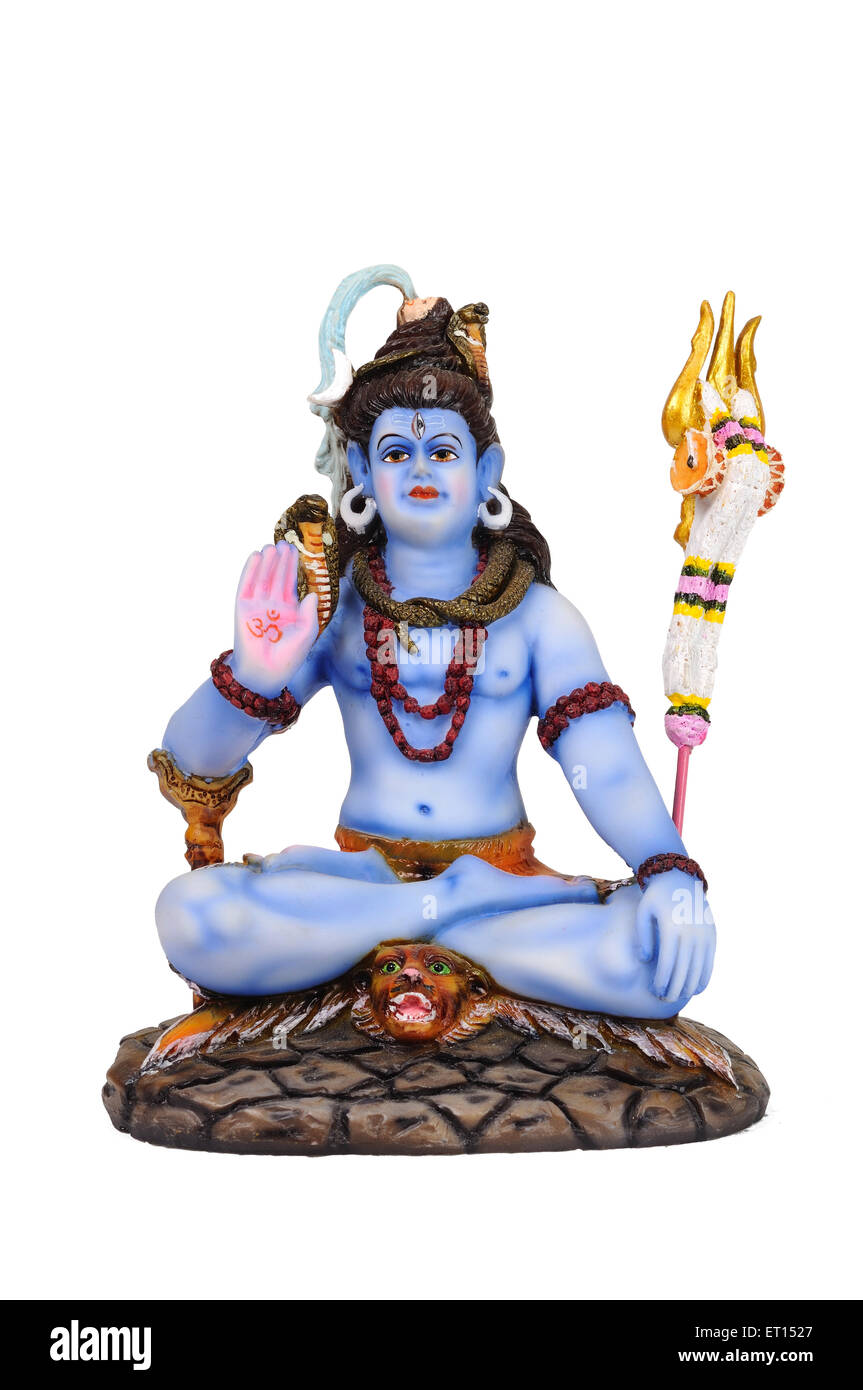 Clay statue of lord shiva sitting on tiger skin - Stock Image