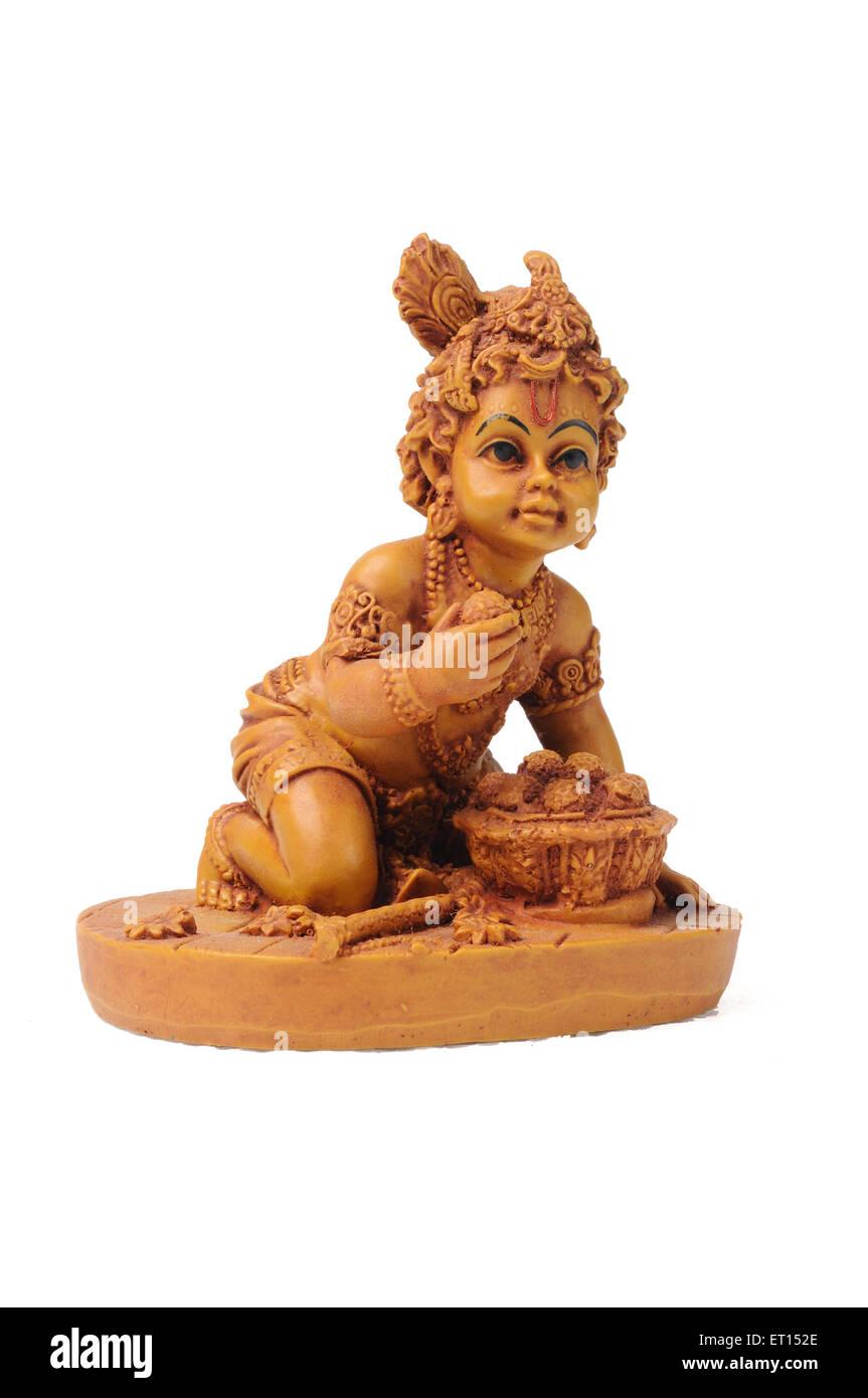 Clay statue of bal krishna - Stock Image