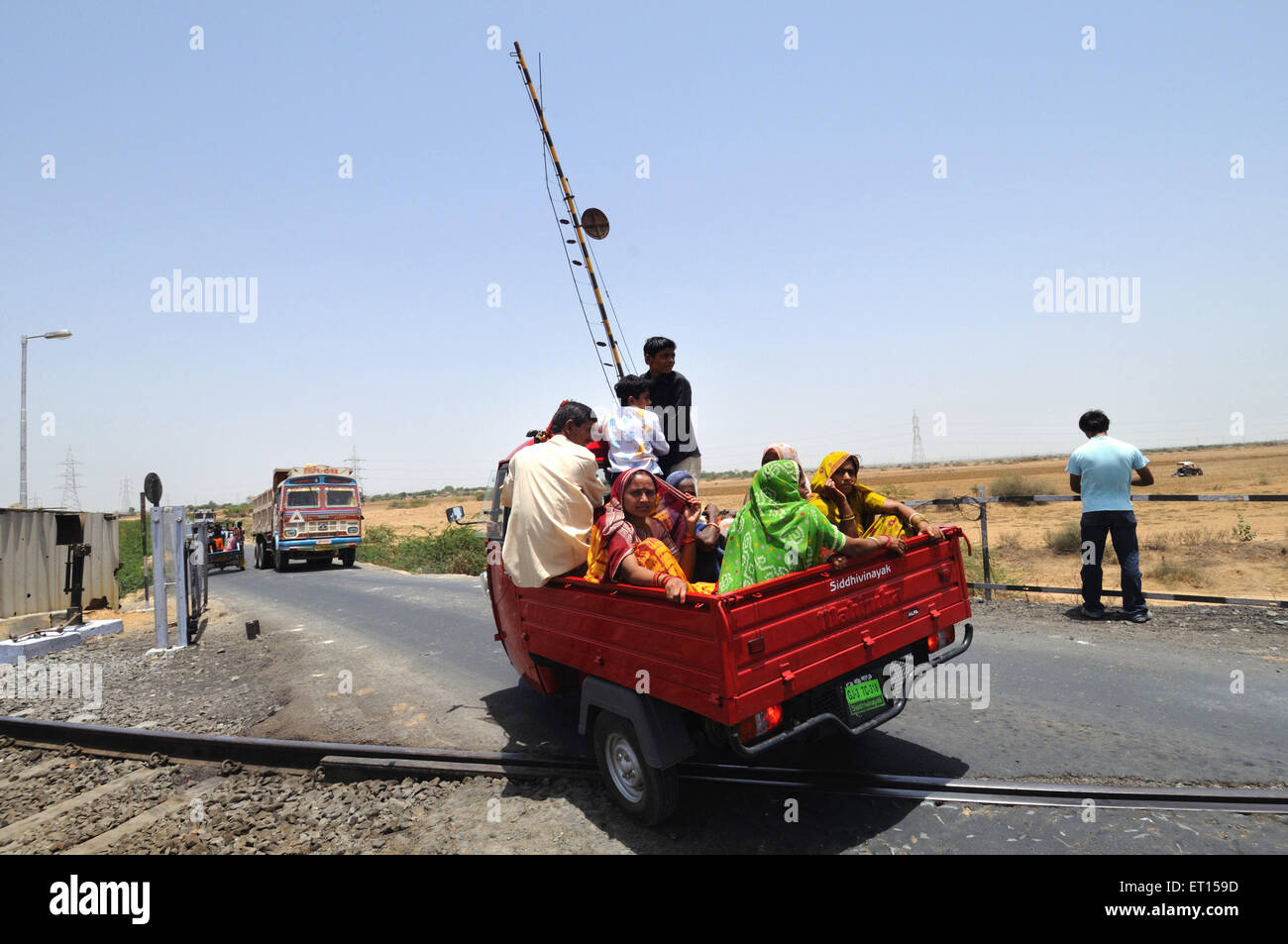 Mode of public transport near railway crossing ; Kutch ; Gujarat ; India - Stock Image