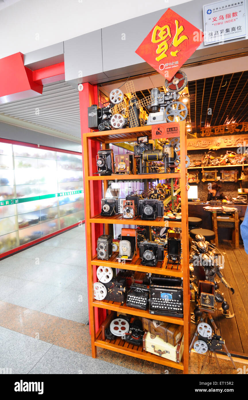Display of antique cameras projectors and scriptures at Chinese Shop ; Yiwu ; China - Stock Image